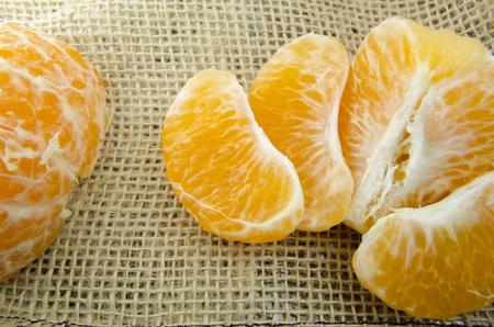 Open tangerine on fabric Stock Photo