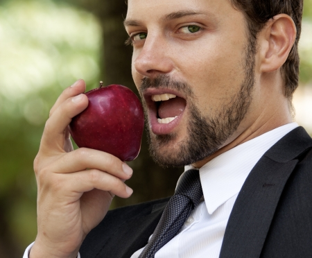 man with apple Stock Photo