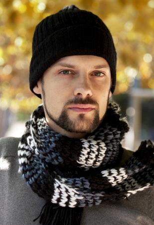 man in the fall with scarf and hat