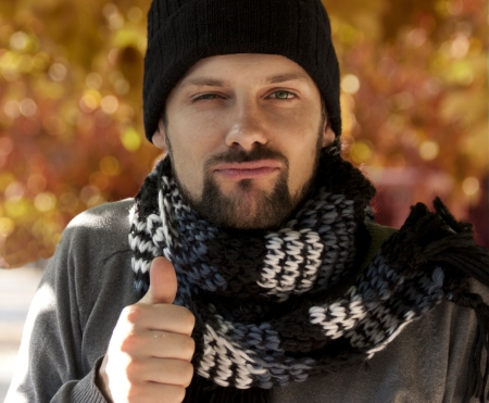 Man with hat and scarf marks ok Stock Photo
