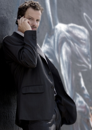 man on a cell phone and background metropolitan murals angel photo