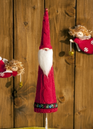 festoons: christmas decorations on wooden background