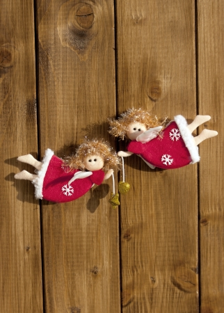 Christmas decorations on wooden background angels photo