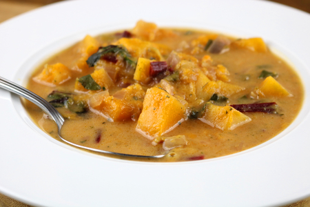 A bowl of freshly prepared Caribbean vegetable soup Imagens