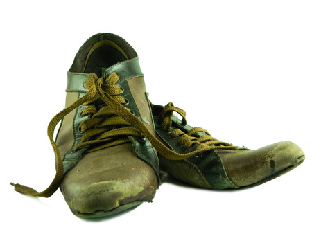 worn out: Old worn out boots, isolated on white Stock Photo