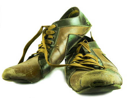 worn: Old worn out boots, isolated on white Stock Photo