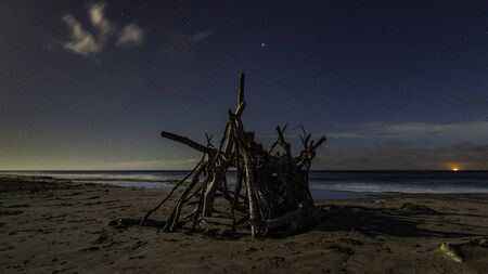 Moon lite beach at night with all the stars Banco de Imagens