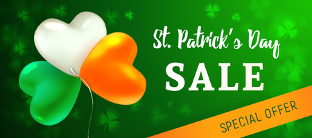 St Patricks Day Sale. Glossy heart-shaped balloons painted in the colors of the Irish flag. Blurred background with leaves of shamrock. Design concept for advertising banner, poster or flyer. 写真素材 - 117974865