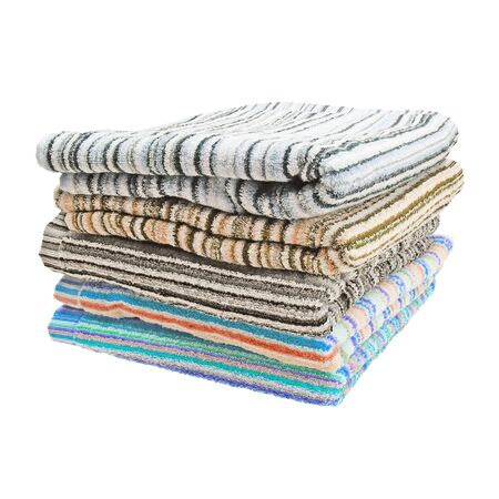 Stack of terry towels. Striped towels. Different colors. Five pieces. Isolated image on white background. Set.