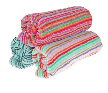 Set. Three rolled terry towels. Striped towels. Different colors. Isolated image on white background.