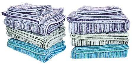 Stack of terry towels. Different colors. Isolated image on white background. Set.