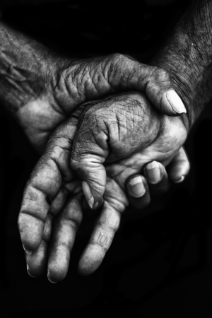 white work: Black and white photo. Hands marked by hard work