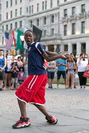 breakdancing: New York City, NY, USA - September 15, 2014. Young boy breakdancing in Grand Army Plaza, Manhattan, New York City.