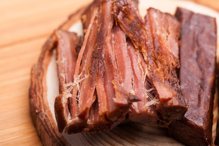 shredding: Shredded beef jerky placed on the board Stock Photo
