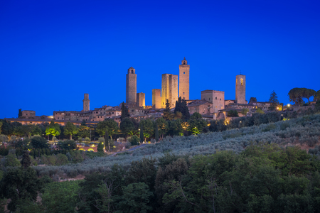 Photo of the panoramic view of the San Gimignano city at sunset