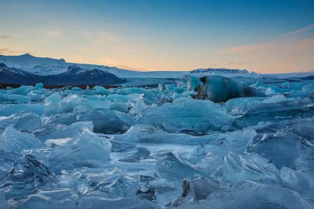 Photo of the Jokulsárlon Glacier Lagoon at sunset with the ice floating