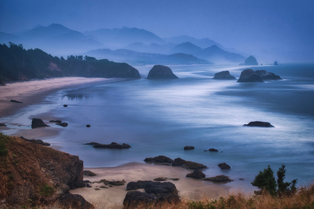 Photo of the panoramic view of the cannon beach in a foggy day