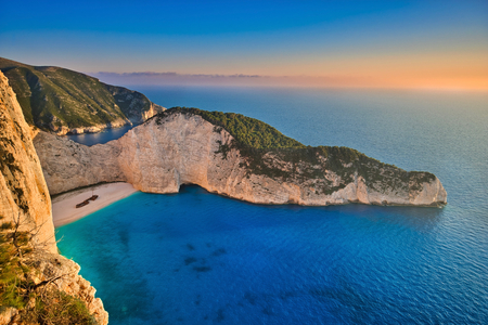 Photo of the sunset at the Greece beach of Navagio
