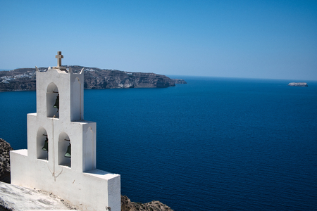 Photo of the Santorini bells and the blue sea