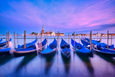 Photo of the sunset time in venice with the gondolas