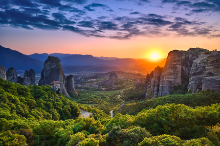 Photo of the panoramic view of the meteora valley at sunset