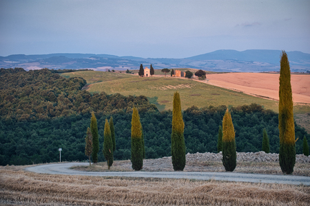 Photo of the chapel on the Val dOrcia at the sunset time