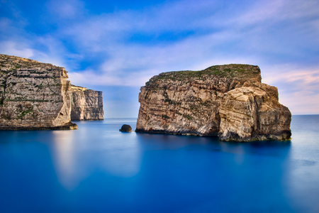Photo of the cliffs of Malta at the sunset time