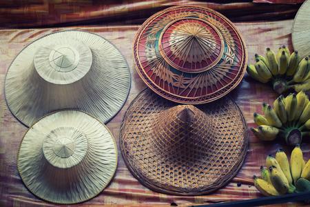 Photo of hats at the Damnoen Saduak Floating Market Stock Photo