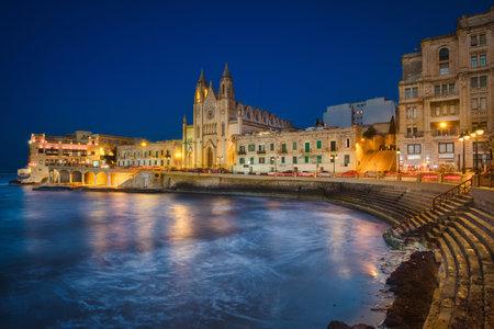 Photo of the San Glijan in Malta at night