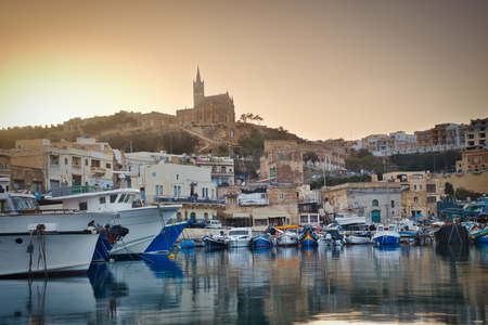 Photo of the Mgarr Village in Gozo Island at the sunset time
