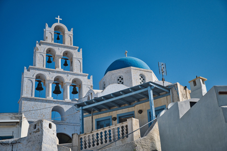 Photo of a greek church in Santorini and the blue sky