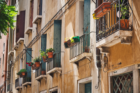 Photo of the balconys  and flowers on Venice Italy Redactioneel
