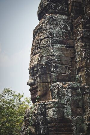 Photo of the statue faces at the Angkor Thom at Cambodia