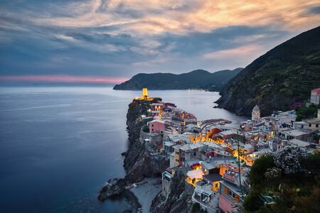 Photo of Vernazza and the night lihgts at the sunset time