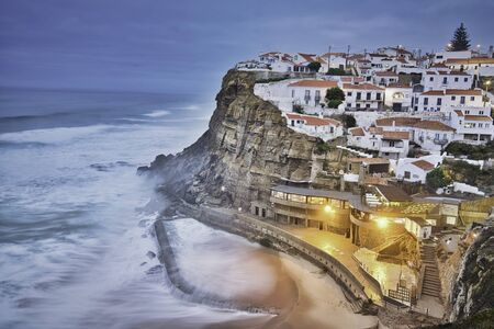 Panoramic photo of the Azenhas do Mar at the sunset time