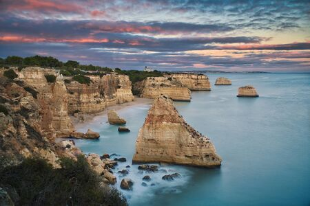 Photo of the rocks in the beach in Lagos Portugal at the sunset time