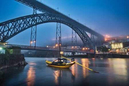 Photo of porto and the Dom Luís bridge at the blue hour time