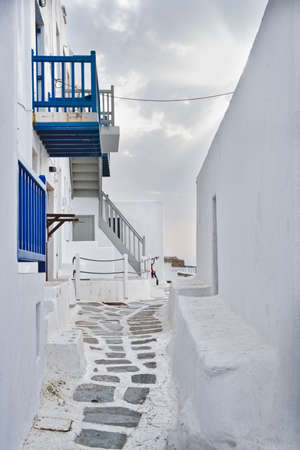 Photo of Mykonos white homes and cloudy sky 스톡 콘텐츠