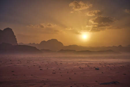 Photo of the landscape of the Wadi Rum Desert at the sunset time