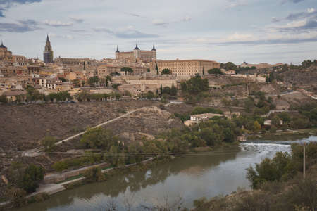 Photo of the panorama view of the medieval city of Toledo in Spain