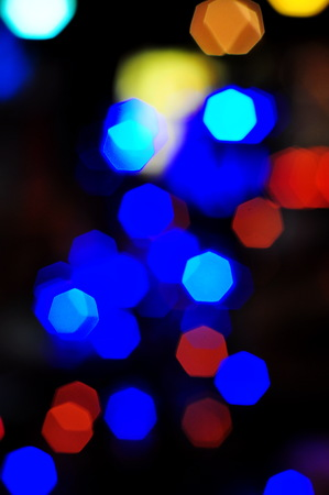 Many colorful heptagon bokeh on night atmosphere. Stock Photo