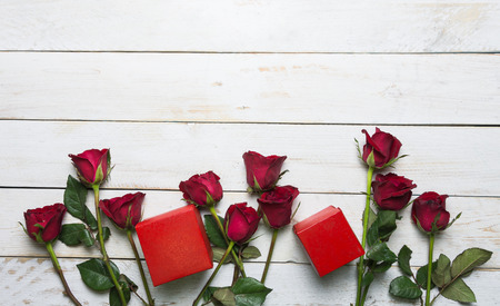 Rose and red gift box Placed on a vintage white wooden background.