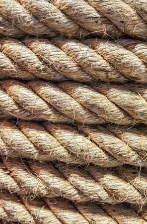 Full frame image of a light brown hemp rope lined well. Reklamní fotografie - 120774456