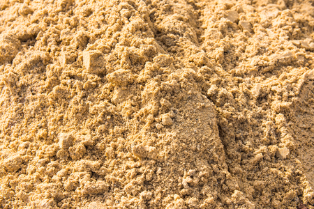 Full frame image of damp sand and clump