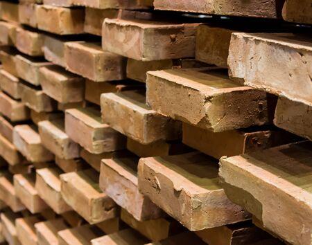 Many terracotta bricks lay stacked together Reklamní fotografie - 134763618