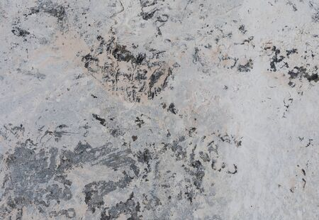 Background image of mud and dust stains of gray cement that are dried from the heat of sunlight. Became a strange pattern Reklamní fotografie - 134763619