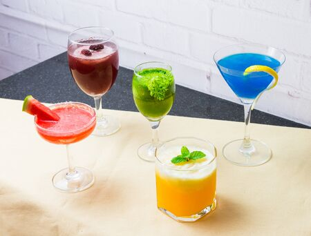 cocktails made from a variety of smoothies, fruits and vegetables, including mulberry, pasley, Cape Gooseberry, Blue Hawaii, watermelon. Packed in different types of glass Reklamní fotografie - 131899618