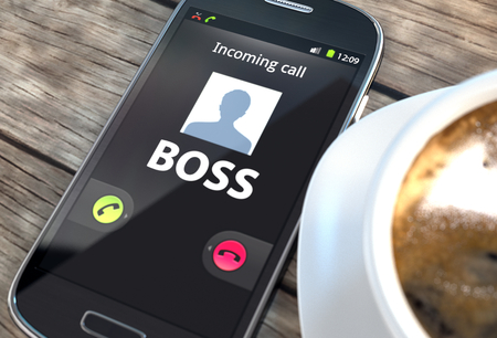 answer phone: Black smartphone with boss calling on screen near coffee cup on a table