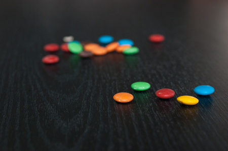 some colorful candies over a wooden table