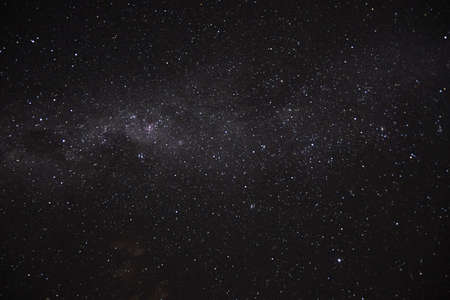 a long exposure of the dark sky with the stars and the milky way and a circumpolar nebulous